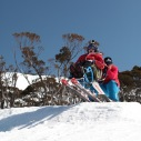 Kenton & Kate riding jumps at Thredbo PHOTO: Alister Buckingham